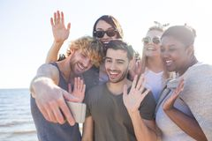 People waving hands while taking selfie Royalty Free Stock Photo