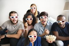 Group of diverse friends watching 3D movie together stock photos