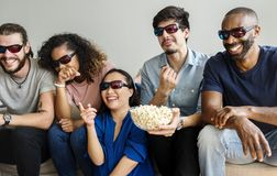 Group of diverse friends watching 3D movie together stock image