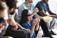 Group of diverse friends watching 3D movie together Royalty Free Stock Images