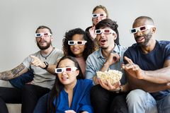 Group of diverse friends watching 3D movie together stock images