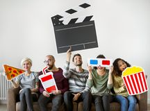 Group of diverse friends watching movie together stock photography