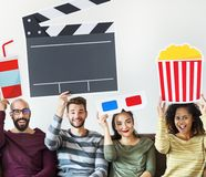 Group of diverse friends watching movie together holding icons royalty free stock photo