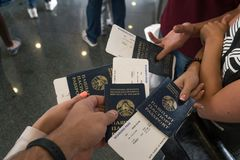 Group of Diverse Friendship Hands Show Passport with Plane Ticket.  Stock Photos