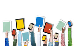 Group of Diverse Hands Holding Digital Devices Stock Image