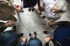 Group of diverse hands holding each other support together teamwork aerial view stock photos