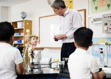 Group of diverse kindergarten students learning experiment in sc Stock Photo
