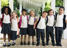 Group of diverse kindergarten students standing together in scho Stock Photography