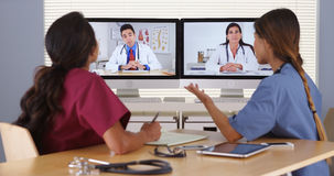 Group of diverse medical doctors video conferencing stock photo