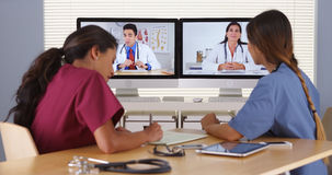 Group of diverse medical doctors video conferencing Royalty Free Stock Images