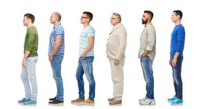 Group of diverse men standing in line. Diversity and people concept - group of happy multiracial men standing in queue, isolated on white royalty free stock photography