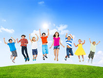 Group of Diverse Multi-Ethinc Children Jumping. Outdoors Stock Photo