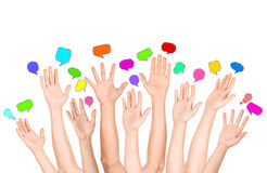 Group of Diverse Multi Ethnic Hands Reaching for Speech Bubbles Stock Photo