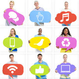 Group of Diverse Multi-Ethnic People Holding Speech Bubbles. With Social Media Icons Stock Photos