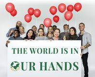 Group of Diverse People with Balloons and Environment Sign Royalty Free Stock Image