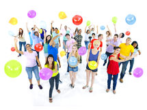 Group of Diverse People Celebrating With Balloons. Group of diverse multi-ethnic young people celebrating with balloons Royalty Free Stock Photos