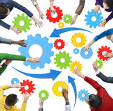 Group of Diverse People with Cog Symbols Concept Royalty Free Stock Image