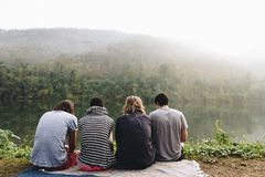 Group of diverse people enjoying the view. From the mountain top Royalty Free Stock Photo