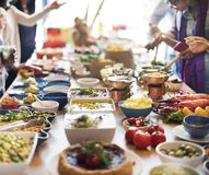 Group of diverse people are having lunch together royalty free stock images