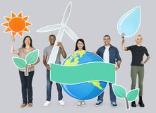 Group of diverse people holding alternative energy icons Stock Photo