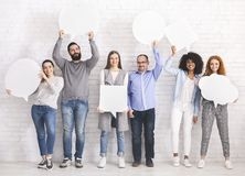 Group of diverse people holding blank speech bubbles stock images