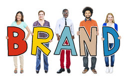 Group of Diverse People Holding Brand Stock Images