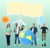 Group of diverse people holding eco-friendly icons stock photos