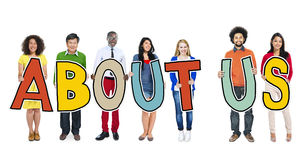 Group of Diverse People Holding About Us.  royalty free stock photography