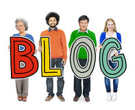 Group of Diverse People Holding the word Blog.  Royalty Free Stock Photography