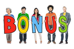 Group of Diverse People Holding Word Bonus Royalty Free Stock Images