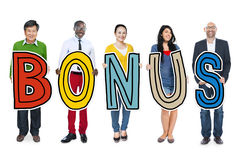 Group of Diverse People Holding Word Bonus.  royalty free stock photos