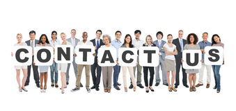 Group Of Diverse People Holding Word Contact Us Stock Photo