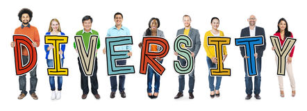 Group of Diverse People Holding Word Diversity.  Stock Photo