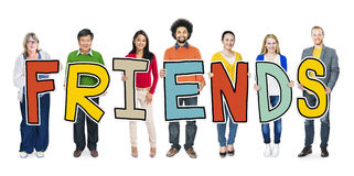 Group of Diverse People Holding Word Friends Royalty Free Stock Photography