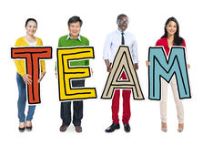 Group of Diverse People Holding Word Team Stock Photography
