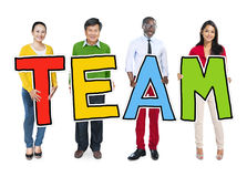 Group of Diverse People Holding Word Team Stock Photos