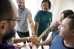 Group of diverse people joined hands together teamwork Royalty Free Stock Photo