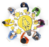 Group of Diverse People with Light Bulb Symbol Royalty Free Stock Photography