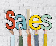 Group of Diverse People's Hands Holding Sales Stock Photo
