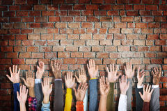 Group of Diverse People's Hands Raised Royalty Free Stock Image