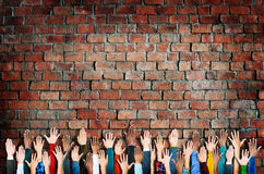 Group of Diverse People's Hands Raised Royalty Free Stock Photo