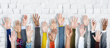 Group of Diverse People's Hands Raised Royalty Free Stock Photography