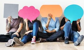 Group of diverse people with speech bubbles icons Royalty Free Stock Image