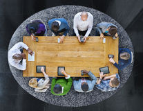 Group of Diverse People in a Table Using Devices Royalty Free Stock Photo