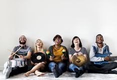 Group of diverse people together enjoying music Stock Photo