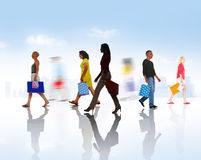 Group of Diverse People Walking with Shopping Bags Royalty Free Stock Photography