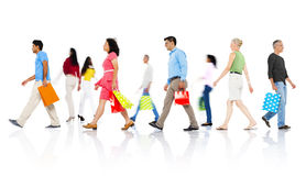 Group of Diverse People Walking with Shopping Bags Royalty Free Stock Images