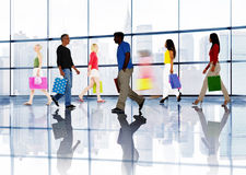 Group of Diverse People Walking in a Shopping Mall Stock Photography