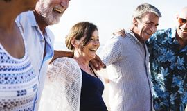 Group of diverse seniors on the beach royalty free stock photo