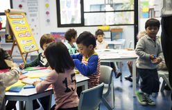 Group of diverse students at daycare. Together stock image
